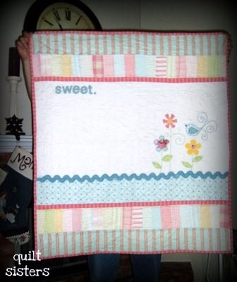 Jennifer - Quilting Sisters quilt made using applique from smock